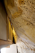 Festus, Missouri: The hallway outside the bedrooms butts up against the cave wall of Curt and Deborah Sleeper's 2,000 square foot home. It is built inside a 17,000 square foot cave in this small town south of St. Louis.
