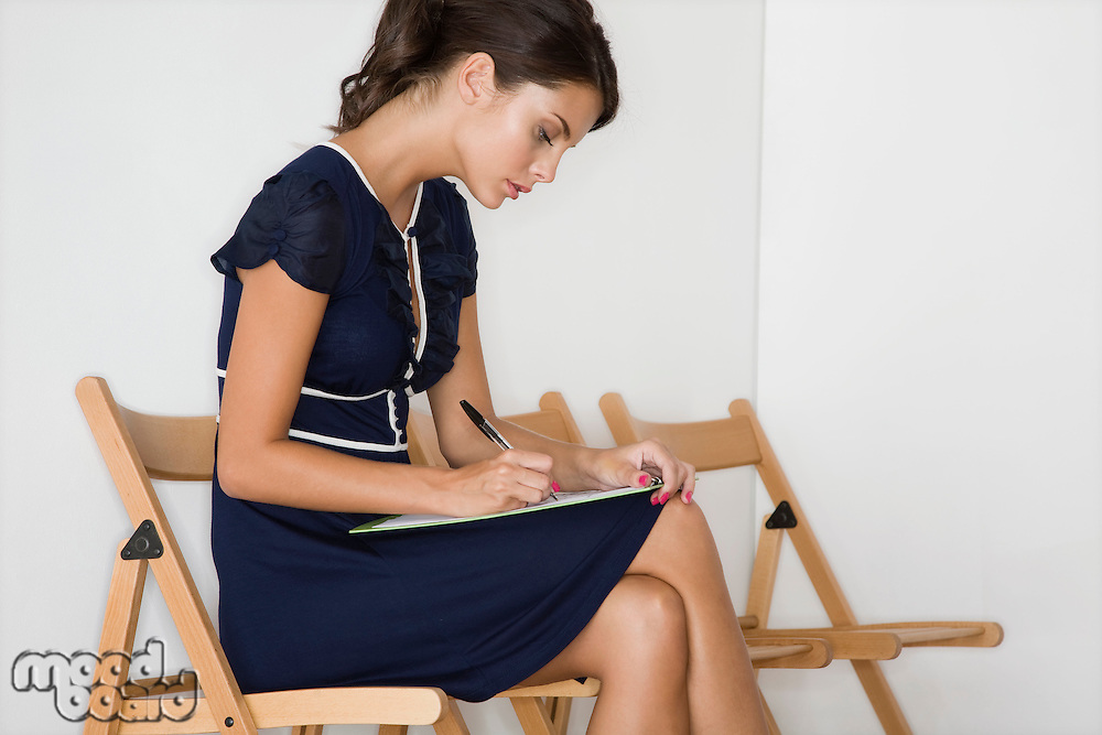 Woman writing half length
