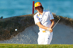 Feb 8, 2012; Pebble Beach CA, USA;  Rickie Fowler hits out of a sand trap on the fourth hole during the practice round of the AT&T Pebble Beach Pro-Am at Pebble Beach Golf Links. Mandatory Credit: Jason O. Watson-US PRESSWIRE