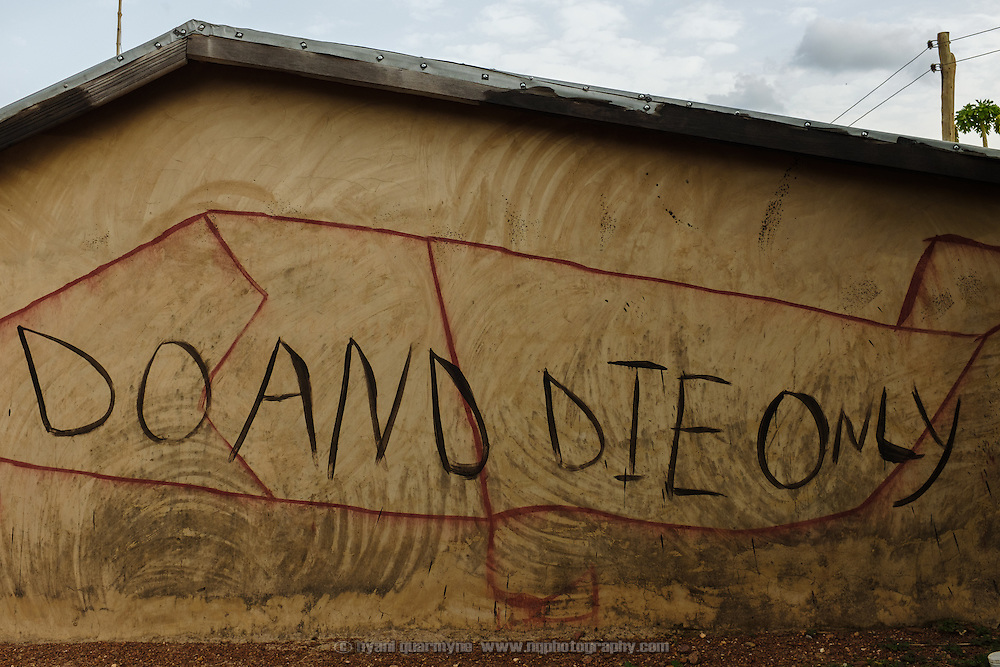 """The words """"Do and die only"""", perhaps a corruption of """"do or die"""", painted on the wall of a house in the village of Kangpuo in the Upper West region of Ghana on 25 June 2015."""