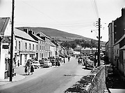 "Fair Day at Baltinglass.17/06/1957..Baltinglass is a town in south-west County Wicklow, Ireland. It is situated on the River Slaney near the border with County Carlow and County Kildare, on the N81 road. Its Irish name means ""the way of Conglas"", Conglas being a member of the mythological warrior collective, the Fianna. A previous Irish-language name for the village, bringing to mind its monastic past, was Mainistir an Bhealaigh."
