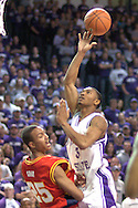 Kansas State guard Lance Harris (R) gets called for the charge, as he drive into Iowa State's Jessan Gray (L) in the second half at Bramlage Coliseum in Manhattan, Kansas, February 8, 2006.  K-State defeated the Cyclones 66-63.