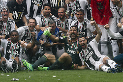 May 19, 2018 - Turin, Italy - Juventus team celebrates during the prize giving ceremony holding the Serie A soccer title trophy  after the Serie A football match n.38 JUVENTUS - VERONA on 19/05/2018 at the Allianz Stadium in Turin, Italy. (Credit Image: © Matteo Bottanelli/NurPhoto via ZUMA Press)