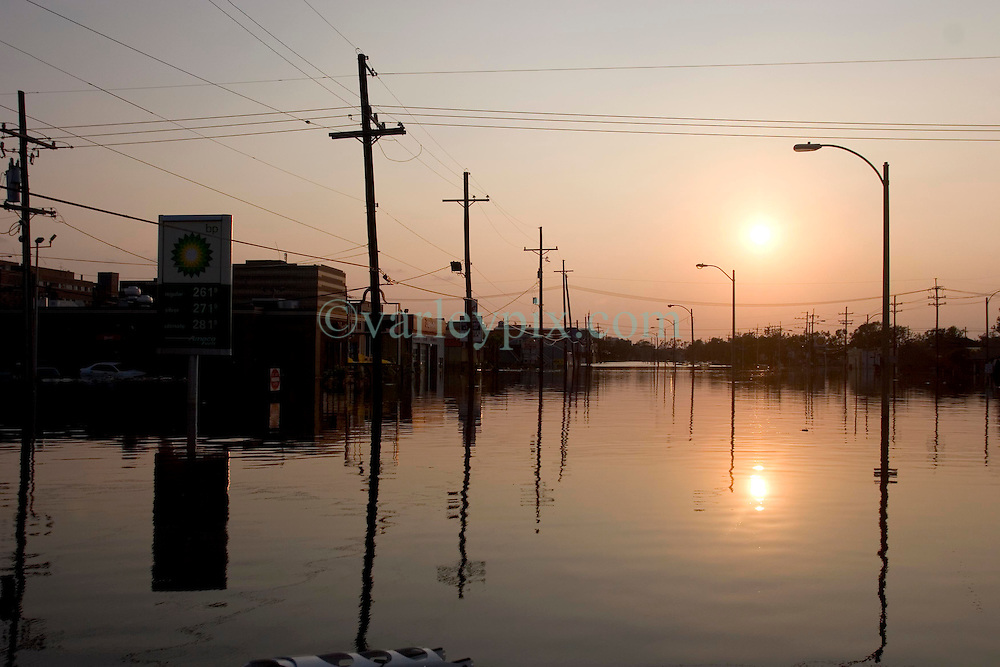 05 Sept  2005. New Orleans, Louisiana. Post hurricane Katrina.<br /> Animal rescue boat.  The sun drops in the horizon over a devastated New Orleans.<br /> Photo; &copy;Charlie Varley/varleypix.com
