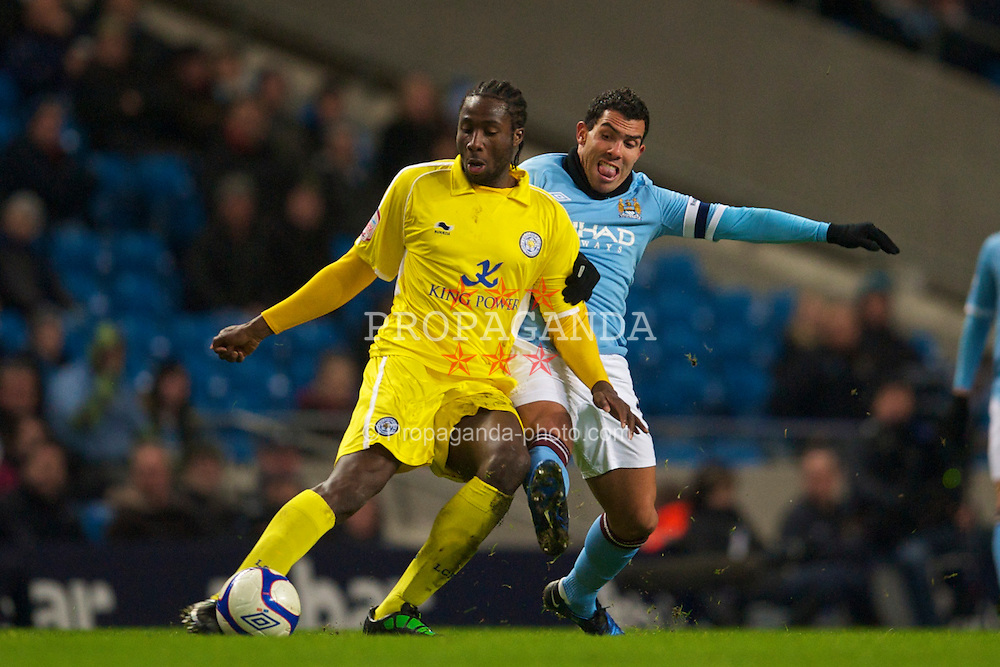 MANCHESTER, ENGLAND - Tuesday, January 18, 2011: Manchester City's Carlos Tevez and Leicester City's Souleymane Bamba during the FA Cup 3rd Round Replay match at the City of Manchester Stadium. (Photo by David Rawcliffe/Propaganda)