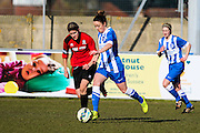 Brighton's Sophie Perry is shadowed by Hassocks Liz King during the FA Women's Sussex Challenge Cup semi-final match between Brighton Ladies and Hassocks Ladies FC at Culver Road, Lancing, United Kingdom on 15 February 2015. Photo by Geoff Penn.