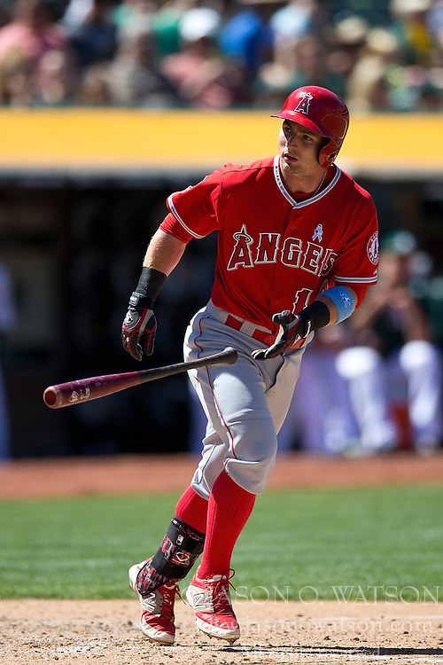 OAKLAND, CA - JUNE 21:  Johnny Giavotella #12 of the Los Angeles Angels of Anaheim tosses his bat after drawing a walk against the Oakland Athletics during the eighth inning at O.co Coliseum on June 21, 2015 in Oakland, California. The Oakland Athletics defeated the Los Angeles Angels of Anaheim 3-2. (Photo by Jason O. Watson/Getty Images) *** Local Caption *** Johnny Giavotella