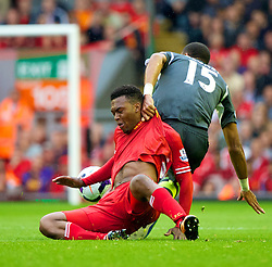 LIVERPOOL, ENGLAND - Saturday, August 17, 2013: Liverpool's Daniel Sturridge in action against Stoke City's Steven N'Zonzi during the Premiership match at Anfield. (Pic by David Rawcliffe/Propaganda)