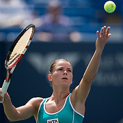 August 16, 2014, New Haven, CT:<br /> Camila Giorgi serves during a match against Coco Vandeweghe on day three of the 2014 Connecticut Open at the Yale University Tennis Center in New Haven, Connecticut Sunday, August 17, 2014.<br /> (Photo by Billie Weiss/Connecticut Open)