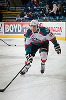 KELOWNA, CANADA - MARCH 7: Devante Stephens #21 of Kelowna Rockets warms up against the Spokane Chiefs on March 7, 2015 at Prospera Place in Kelowna, British Columbia, Canada.  (Photo by Marissa Baecker/Shoot the Breeze)  *** Local Caption *** Devante Stephens';