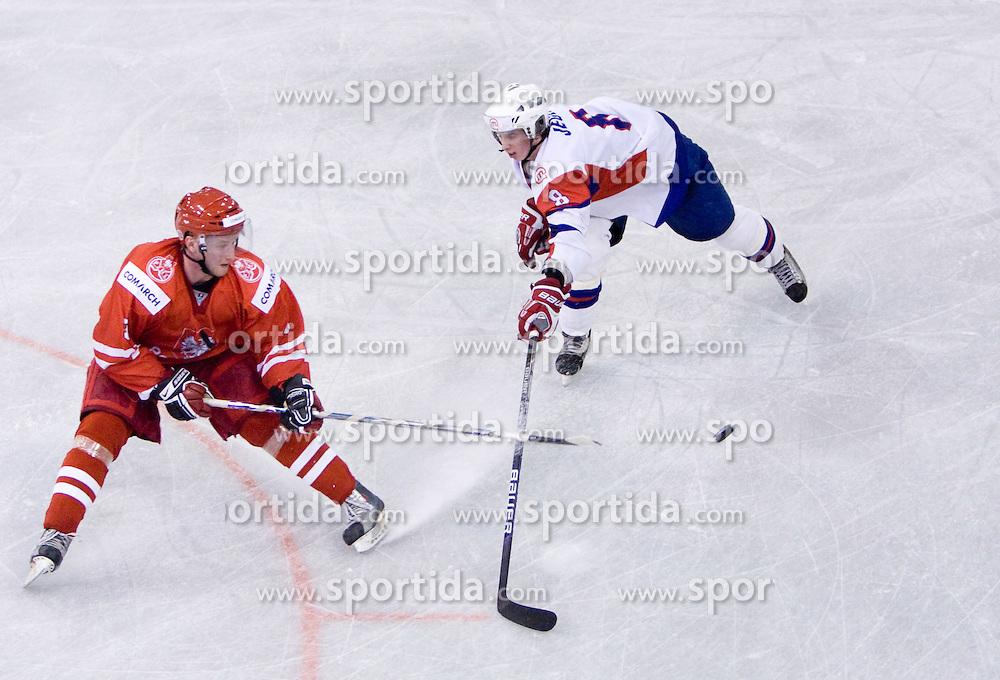 Michal Kotlorz of Poland vs Ziga Jeglic of Slovenia at IIHF Ice-hockey World Championships Division I Group B match between National teams of Slovenia and Poland, on April 17, 2010, in Tivoli hall, Ljubljana, Slovenia. (Photo by Vid Ponikvar / Sportida)