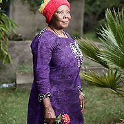 """Portrait of Sista Gwendolyn (Mama).<br /> <br /> Originally from Jamaica, Mama repatriated to Shashamane 40 years ago. She is one of the earlier Rastafarians to settle.<br /> <br /> """"you could see tree's all the way up and down"""" she recounts with a reminiscent grin when asked what Shashamane was like in those days. """"It was better then as too many buildings now"""".<br /> <br /> Mama has a charming character and is very respected in the community. She makes dresses in Ghanaian designs and is also a wonderful cook."""
