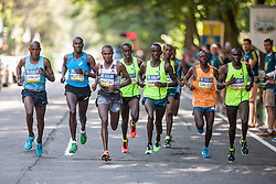 Boston Athletic Association 10K road race: lead pack of men, all Kenyan, passing mile one led by Geoffrey Mutai