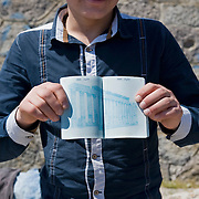 An 18 year old Syrian refugee showing me his unstamped passport in the port of Molyvos, Lesbos island, hours after his boat has been rescued by the Greek Coast Guard.