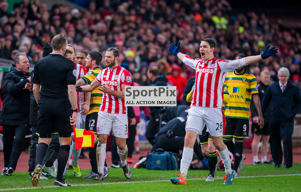 Stoke City defender Philipp Wollscheid (26) appeals to the linesman after the foul by Norwich City midfielder Gary O'Neil (28) which earned the player a red card
