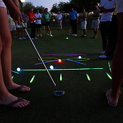 A glow in the dark putting contest in Scottsdale, Arizona.