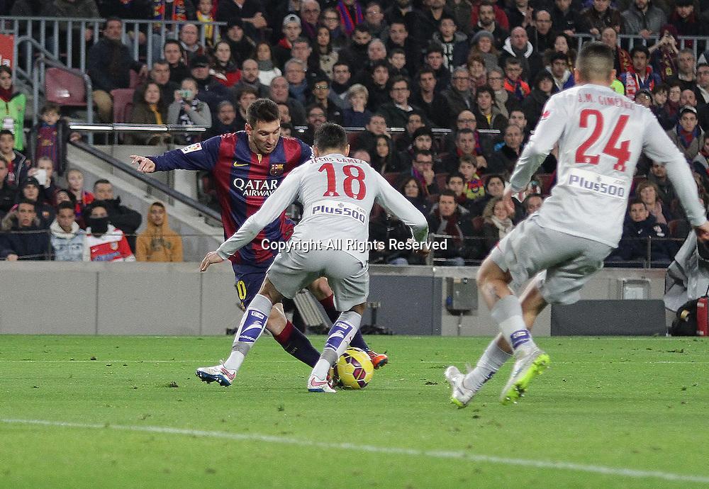 11.01.2015. Barcelona, Spain. La liga football. Barcelona versus Atletico Madrid. Messi in action challenged by Gamez