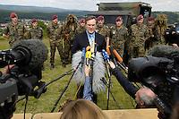 07 JUN 2006, MERZIG/GERMANY:<br /> Franz Josef Jung, CDU, Bundesverteidigungsminister, waehrend einer Pressekonferenz, im Rahmen eines  Truppenbesuchs beim Luftlandeunterstuetzungsbataillon 262 - das Bataillon gehoert zur Luftlandebrigade 26, die am Einsatz der Bundeswehr im Rahmen der EU Mission EUFOR RD Congo teilnehmen wird - Truppenuebungsplatz<br /> IMAGE: 20060607-01-043<br /> KEYWORDS: Mikrofon, microphone, Kamera, Camera, Soldat, Soldaten
