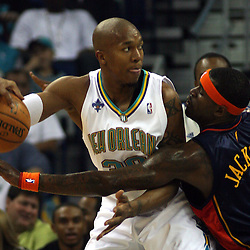 New Orleans Hornets forward David West #30 drives in as Stephen Jackson #1 of the Golden State Warriors defends in the first half of their NBA game on April 6, 2008 at the New Orleans Arena in New Orleans, Louisiana.