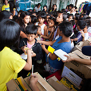 Food distribution in connection with a pedicure workshop set up in the slums along side a film screening on human trafficking. There is very little work in the slums and many women do not have any vocational training so being able to set up a small shop in the streets providing pedicure is a great help to many women.  Because of poverty and lack of income children and young women are easy prey to human traffickers and the foundation aim to teach the dangers of trafficking by showing films in a mobile cinema. Laura Vicuña is a non-profit charity working in Manila and in Bacolod in the state Negros Occidental in the Philippines.