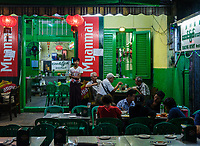 YANGON, MYANMAR - CIRCA DECEMBER 2017: Restaurant in Chinatown at night, the area is popular with backpackers due to the street food stalls and vendors.