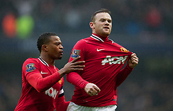 MANCHESTER, ENGLAND - Sunday, January 8, 2012: Manchester United's Wayne Rooney celebrates scoring the first goal against Manchester City with team-mate and captain Patrice Evra during the FA Cup 3rd Round match at the City of Manchester Stadium. (Pic by Vegard Grott/Propaganda)