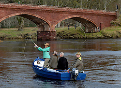 Pictured: adventurer Polly Murray casts the first fly of the new season.<br /> <br /> Anglers from all over the country arrived in Kinclaven, Perthshire for the first day of the new salmon fishing season on the River Tay, which is marked with whisky and sees the anglers led to the water by pipers.<br /> <br /> <br /> &copy; Dave Johnston / EEm