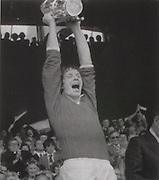 Cork captain, Martin O'Doherty raises the McCarthy Cup in 1977.