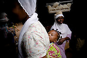 Baby girl on the back of her mother in the market in Tamale, Ghana on Sunday June 3, 2007.
