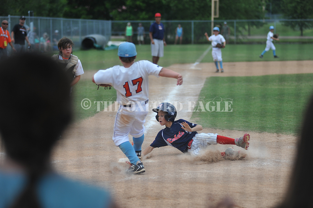 Mississippi Rebels vs. Mississippi Marlins in the 2015 Mississippi USSSA 9U State Championship at FNC Park at FNC Park in Oxford, Miss. on Sunday, June 21, 2015.