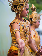 05 DECEMBER 2014 - BANGKOK, THAILAND:  Thai women perform a classical Thai dance on Sanam Luang for observances of the King's Birthday. Thais marked the 87th birthday of Bhumibol Adulyadej, the King of Thailand, Friday. The King was born on December 5, 1927, in Cambridge, Massachusetts. The family was in the United States because his father, Prince Mahidol, was studying Public Health at Harvard University. He has reigned since 1946 and is the world's currently reigning longest serving monarch and the longest serving monarch in Thai history. Bhumibol, who is in poor health, is revered by the Thai people. His birthday is a national holiday and is also celebrated as Father's Day. He is currently hospitalized in Siriraj Hospital, recovering from a series of health setbacks.    PHOTO BY JACK KURTZ