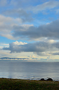 Early morning in Reykjavik Iceland beautiful view of cumulus clouds, blue sky, mountains, fog and sea