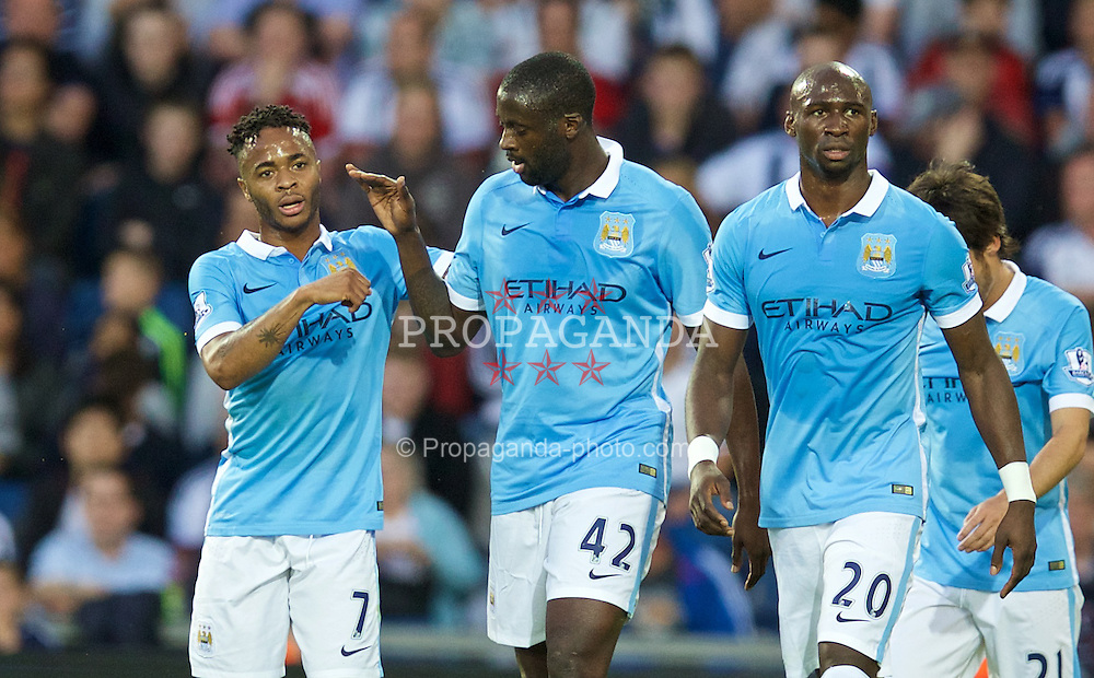 WEST BROMWICH, ENGLAND - Monday, August 10, 2015: Manchester City's Yaya Toure celebrates scoring the second goal against West Bromwich Albion with team-mate Raheem Sterling during the Premier League match at the Hawthorns. (Pic by David Rawcliffe/Propaganda)
