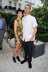 LIBERTY ROSS and her husband RUPERT SAUNDERS at the Tatler Summer Party, The Hempel Hotel, 31-35 Craven Hill Gardens, London W2 on 25th June 2008.<br />