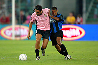 Bari 3/8/2004 Trofeo Birra Moretti - Juventus Inter Palermo. <br /> <br /> Luca Toni Palermo challenged by Ivan Cordoba Inter <br /> <br /> Risultati / results (gare da 45 min. each game 45 min.) <br /> <br /> Juventus - Inter 1-0 Palermo - Inter 2-1 Juventus b. Palermo dopo/after shoot out <br /> <br /> Photo Andrea Staccioli