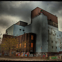 An abandoned factory building in an urban setting