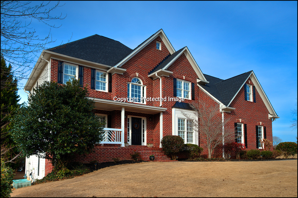 Interior and exterior photographs of a house for sale in Woodstock, GA