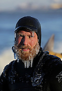 Icicles form on the beard of Mike Killion of Chicago after surfing in subzero wind chills at Whihala Beach in Whiting, Ind. on January 12, 2016.