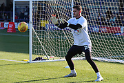 AFC Wimbledon goalkeeper Joe McDonnell (24) warming up during the EFL Sky Bet League 1 match between AFC Wimbledon and Shrewsbury Town at the Cherry Red Records Stadium, Kingston, England on 3 November 2018.