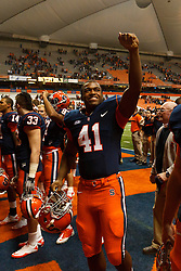 Oct 21, 2011; Syracuse NY, USA;  Syracuse Orange defensive end Donnie Simmons (41) celebrates with teammates after the game against the West Virginia Mountaineers at the Carrier Dome.  Syracuse defeated West Virginia 49-23. Mandatory Credit: Jason O. Watson-US PRESSWIRE
