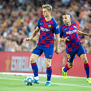 BARCELONA, SPAIN - August 25:  Frenkie de Jong #21 of Barcelona and Jordi Alba #18 of Barcelona during the Barcelona V  Real Betis, La Liga regular season match at  Estadio Camp Nou on August 25th 2019 in Barcelona, Spain. (Photo by Tim Clayton/Corbis via Getty Images)