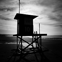 Photo of Newport Beach lifeguard tower 10 on Balboa Peninsula. Newport Beach is a beach city  along the Pacific Ocean in Orange County Southern California.