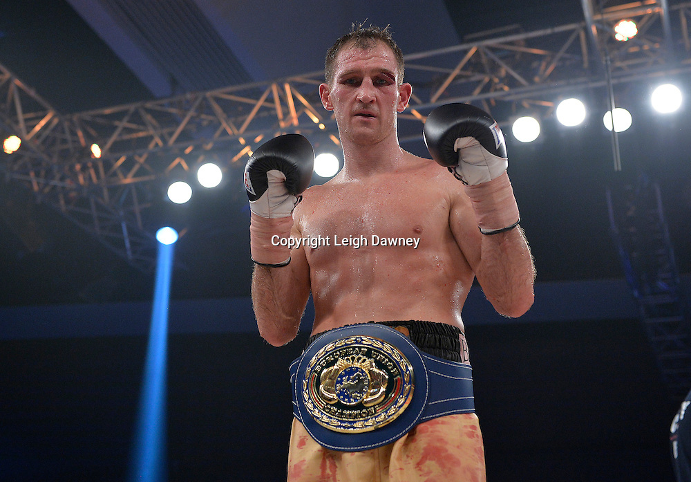 Lenny Daws claims the Vacant EBU Light Welterweight Title at Glow, Bluewater, Kent following his fight with Chaquib Fadli on the 8th November 2014. Promoter: Hennessy Sports. © Leigh Dawney Photography 2014.