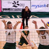 3rd year middle blocker Cody Caldwell (4) of the Regina Cougars and 4th year outside hitter Brennan Goski (13) of the Regina Cougars in action during the Women's Volleyball Home Game vs U of C Dinos on October21 at the CKHS University of Regina. Credit Arthur Ward/©Arthur Images 2017