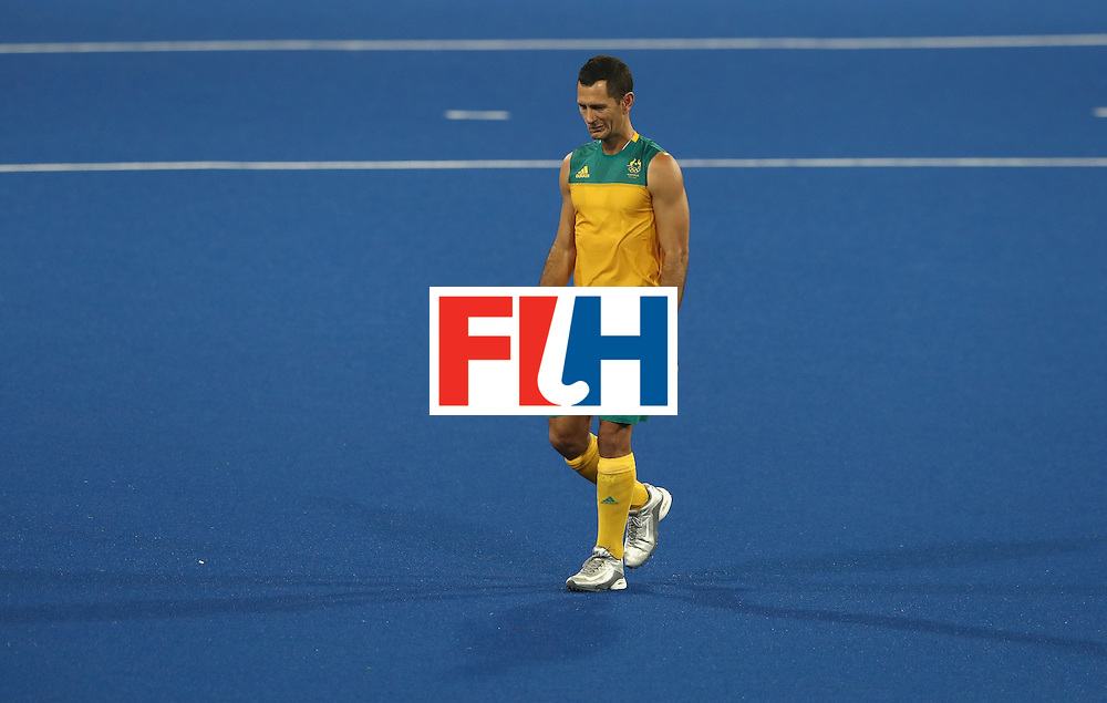 RIO DE JANEIRO, BRAZIL - AUGUST 14:  Jamie Dwyer of Australia looks dejected as he leaves the pitch after Australia's 4-0 defeat during the Men's hockey quarter final match between the Netherlands and Australia on Day 9 of the Rio 2016 Olympic Games at the Olympic Hockey Centre on August 14, 2016 in Rio de Janeiro, Brazil.  (Photo by David Rogers/Getty Images)