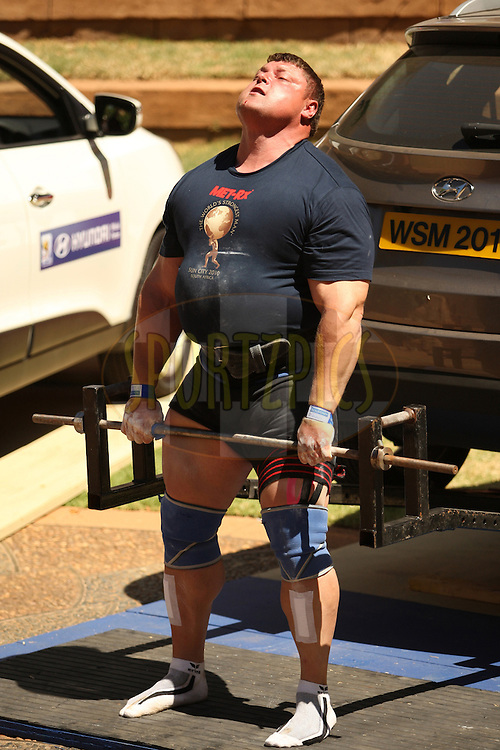Defending champion Zydrunas Savickas (Lithuania) extends for a successful rep in the deadlift despite drops of blood dripping from his nose during the final rounds of the World's Strongest Man competition held in Sun City, South Africa.