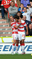 Keshi Anderson (right) of Doncaster Rovers celebrates his opening goal against Barnsley during the Sky Bet League 1 match at the Keepmoat Stadium, Doncaster<br /> Picture by Graham Crowther/Focus Images Ltd +44 7763 140036<br /> 03/10/2015