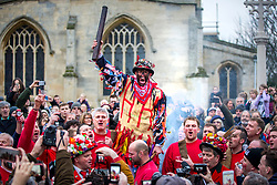 "© Licensed to London News Pictures. 05/01/2019. Haxey UK. Dale Smith ""the Fool"" starts the Haxey Hood game today in the village of Haxey. The traditional game of Haxey Hood is taking place today in Haxey despite only one of the four pubs usually involved taking part. The Kings Arms, Duke William & The Loco pubs will all be closed today leaving just the Westwoodside's Carpenters Arms taking part. The traditional game, which dates from 1359, sees drinkers from pubs in the two villages attempt to win the Hood – a tube of leather – by 'swaying' it to their favoured watering hole in a muddy and bruising encounter which can take hours. Normally, victory is declared when the landlord of the winning pub takes delivery of the Hood on the pub doorstep but in the event of a Haxey win this year, a win will be claimed when the Hood reaches a pre-detemined point near the Kings Arms. Photo credit: Andrew McCaren/LNP"