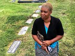 August 16, 2017 - Los Angeles, California, U.S. - MONIQUE EDWARDS talks about the the Confederate monument that used to stand near these graves of Confederate soldiers at the Hollywood Forever Cemetery in Hollywood. The monument was removed earlier in the morning, following a violent white nationalist rally in Charlottesville, Virginia, on Saturday over Confederate statues. (Credit Image: © Los Angeles Daily News via ZUMA Wire)