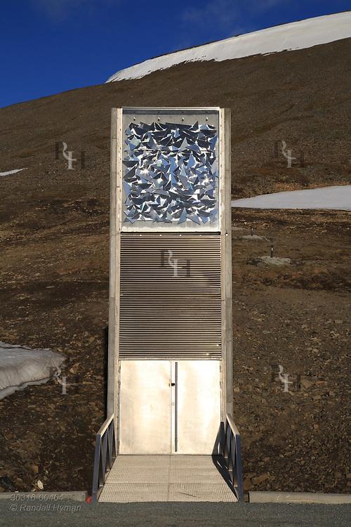 Global Seed Vault looms from rocky hillside in mid summer in Longyearbyen on Spitsbergen island, Svalbard, Norway.